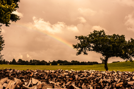 Countryside scenery with a rainbow and cloudy weather