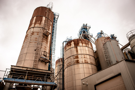 Industrial silos in a old rusty inviroment Stock Photo - 23258518
