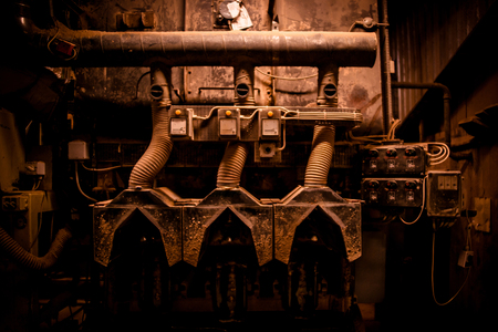 Grunge machinery in industrial surroundings