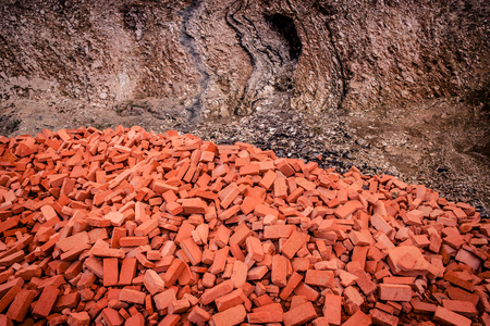 Pile of red bricks in a canyon photo