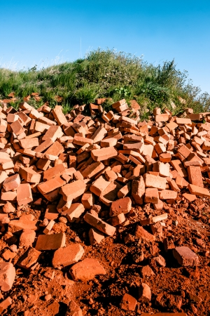 Pile of red bricks in the nature photo