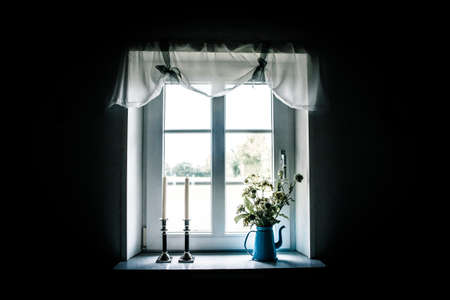 Romantic window with beautiful curtains and decorations photo