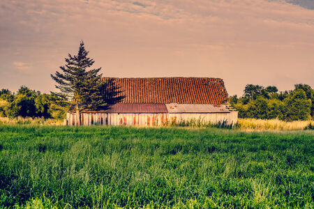 Countryside scenery with an old and weathered barn photo