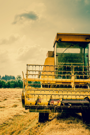 Close-up photo of a yellow harvester machine photo