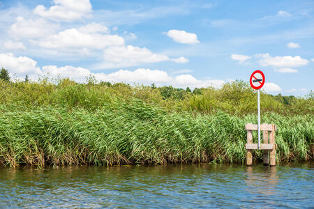 Lake scenery with a red no boating sign photo