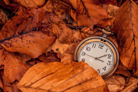 Clock showing that autumn is coming Stock Photo
