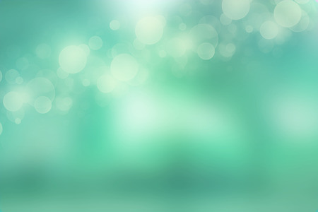 Bokeh lights on fresh mint green background