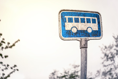 old service station: Retro bus stop sign in blue color