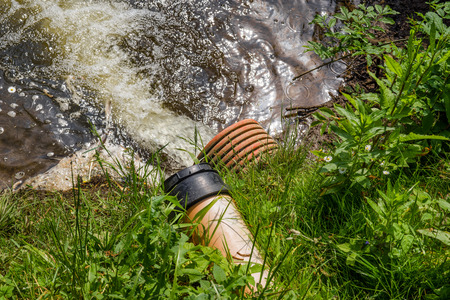 admixture: Pipe with spill water at a lake