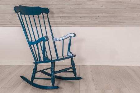 Blue rocking chair in a living room
