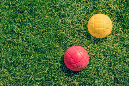bocce: Red and yellow ball of a boccia garden game on the lawn Stock Photo