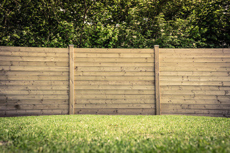 pasture fence: Wooden fence on a green lawn