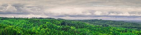 Panorama landscape from Denmark with green trees and cloudy weather Stock Photo