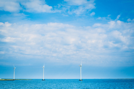 ocean: Windmills on a row in the blue ocean Stock Photo