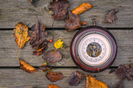 barometer: Barometer on wooden planks in the autumn