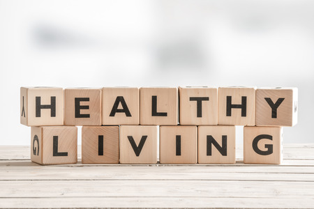 Healthy living sign with wooden cubes on a table Stok Fotoğraf - 54123760