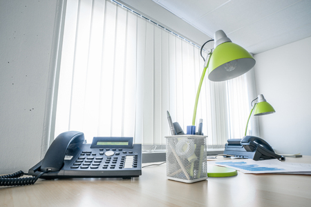 dayplanner: Office desk with a phone and green lamps