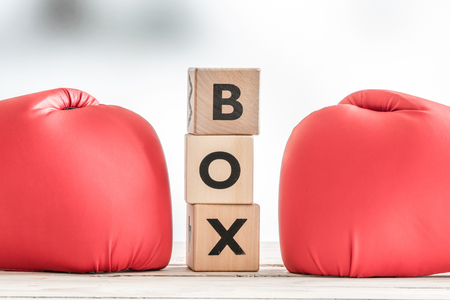destroying the competition: Boxing gloves and a boxing sign on a wooden table