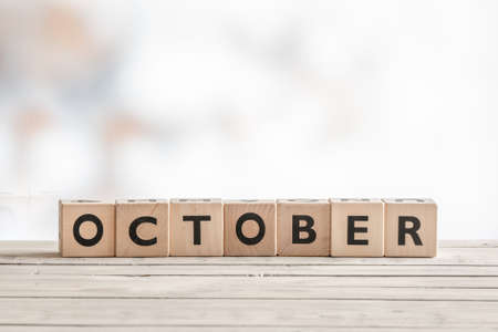 learning series: October sign made of wooden cubes on a desk