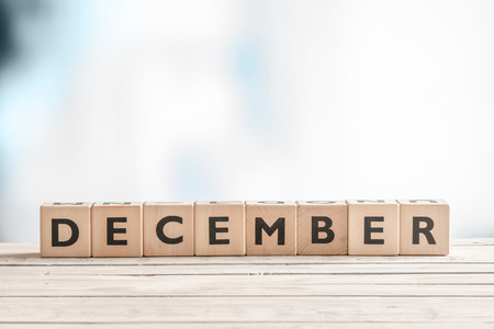 December label made of wooden cubes on a table Stock Photo