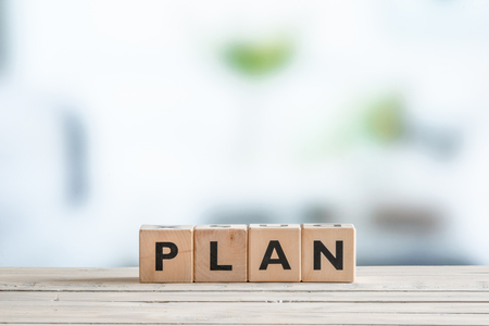action plan: Plan word on wooden cubes on a table Stock Photo