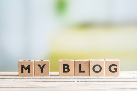 artistic addiction: Personal blog sign on a wooden indoor table Stock Photo