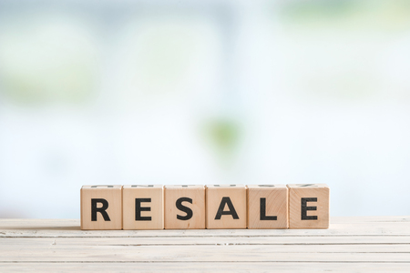 resale: Resale sign made of cubes on a wooden desk Stock Photo