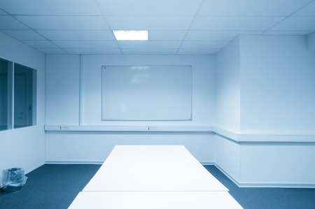blue tone: Conference room with a whiteboard in blue tone