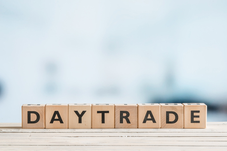 sell shares: Daytrade sign in an office on a wooden desk