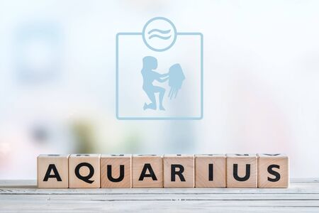 aquarius star: Aquarius star sign on a wooden table Stock Photo
