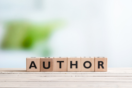 phrase novel: Author sign made of letters on a wooden desk