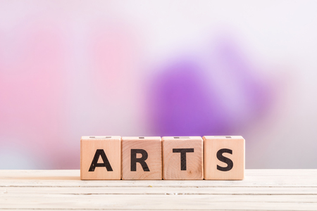 headline: Arts sign headline on a wooden table