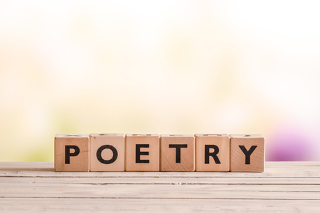 stanza: Poetry word made of wooden cubes on a desk Stock Photo