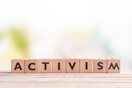activism: Activism word on wooden cubes on a table Stock Photo