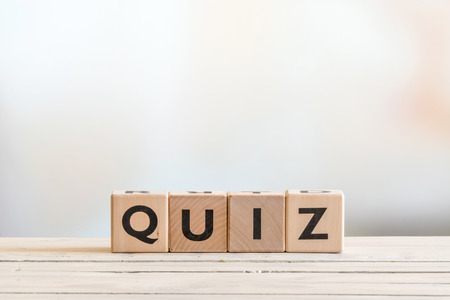 Quiz sign made of wood on a wooden table