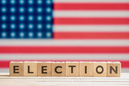 Election sign on a table with the american flag Stock Photo