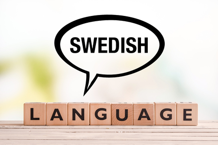 education in sweden: Swedish language lesson sign made of cubes on a table