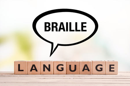 braile: Braille language lesson sign made of cubes on a table Foto de archivo