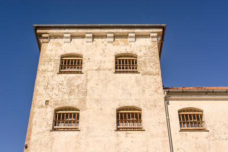 spanish style: Prison building with bars on windows in spanish style