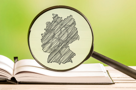 map pencil: Germany with a pencil drawing of a german map in a magnifying glass Stock Photo