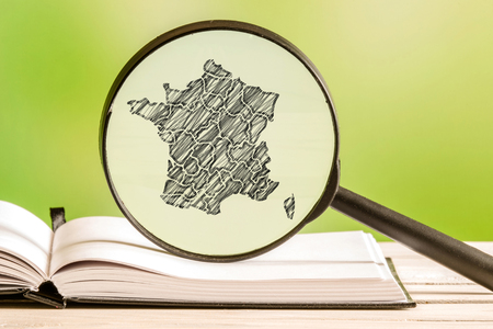 map pencil: France with a pencil drawing of a french map in a magnifying glass
