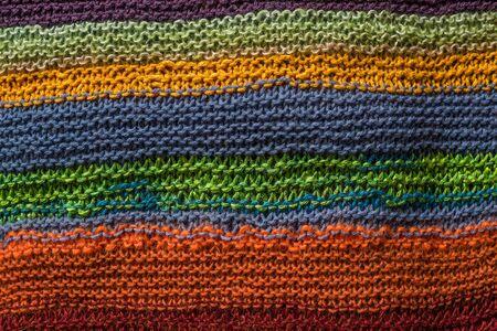 colores calidos: Prendas de punto de fondo en muchos colores cálidos