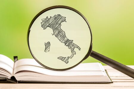 map pencil: Italy with a pencil drawing of a italian map in a magnifying glass Stock Photo