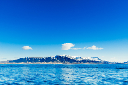coastlines: Blue ocean with distant mountains in the background Stock Photo