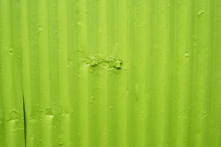 worn: Green metal surface with worn paint and cracks Stock Photo