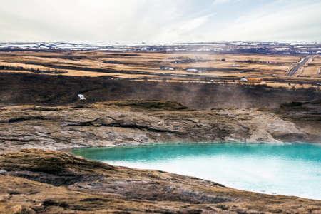sulphur: Geysir geyser in Iceland with steamy blue water