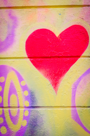 grafitti: Grafitti with a heart on a concrete wall in hippie style Stock Photo