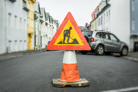 Roadwork sign on a cone at a street Stock Photo