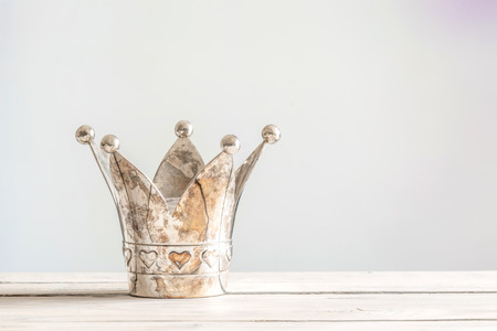 Princess crown with hearts on a wooden table 免版税图像 - 56085743
