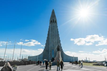 REYKJAVIK, ICELAND - APRIL 9 - 2016: People in front of the Hallgrimskirkja in Reykjavik
